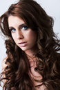 Portrait of beautiful woman with long curly hair Stock Photo