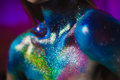 Portrait of beautiful woman painted with cosmic colors and spangled. Royalty Free Stock Photo