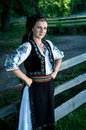 Portrait of beautiful woman posing outside in romanian tra young traditional costume Royalty Free Stock Photography