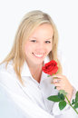 Portrait of a beautiful woman with a red rose. Royalty Free Stock Photos