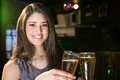 Portrait of beautiful woman toasting her beer glass Royalty Free Stock Photo