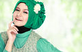 Portrait of beautiful woman wearing hijab fashion young happy muslim with green costume Stock Photo