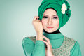 Portrait of beautiful woman wearing hijab fashion young muslim with green costume Stock Photos