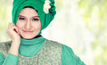 Portrait of beautiful woman wearing hijab fashion young muslim with green costume Royalty Free Stock Images