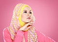 Portrait of beautiful woman wearing hijab fashion young muslim with pink costume Stock Photo
