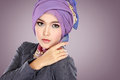 Portrait of beautiful woman wearing hijab fashion young muslim with purple costume Stock Photography