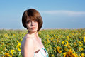Portrait of a beautiful woman young in field with sunflowers Royalty Free Stock Photography