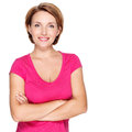 Portrait of a beautiful young adult white happy woman over background wearing pink shirt Stock Photo
