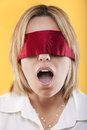 Portrait of a beautiful young blindfold woman Royalty Free Stock Images