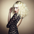 Portrait of beautiful young blonde girl in black dress Royalty Free Stock Photo