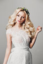 Portrait of a beautiful young blonde woman with long curly hair and eyes Royalty Free Stock Photo