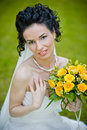 Portrait of beautiful young bride in garden Stock Image