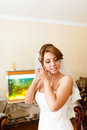 Portrait of a beautiful young bride who wears an earring Royalty Free Stock Photo