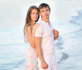 Portrait of a beautiful young couple in love in the summer sea Royalty Free Stock Photo