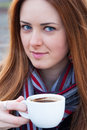 Portrait of a beautiful young girl with blue eyes drinking coff Royalty Free Stock Photo