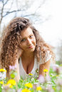 Portrait of beautiful young girl in flower field Royalty Free Stock Photo