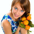 Portrait of a beautiful young girl with tangerines on light background Royalty Free Stock Photography