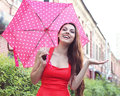 Portrait of beautiful young girl walking with umbrella under the rain Stock Photos
