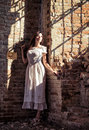 Portrait of beautiful young girl in white dress dramatic a Royalty Free Stock Image