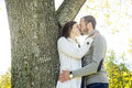 Portrait of beautiful young pair in a park Royalty Free Stock Photo