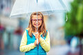 Portrait of beautiful young pre-teen girl with umbrella under rain Royalty Free Stock Photo