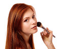 Portrait of beautiful young redheaded woman with esthetician mak making makeup isolated on white background Stock Images