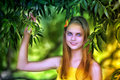 Portrait of a beautiful young teenager girl near tree in summer Stock Photography