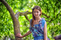 Portrait of a beautiful young teenager girl near tree in summer Stock Photo