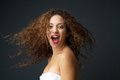 Portrait of a beautiful young woman with blowing hair laughing Royalty Free Stock Photo