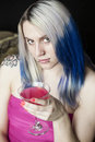Portrait beautiful young woman blue hair pink dress holding pink martini Stock Photography