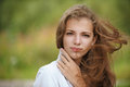 Portrait of beautiful young woman close up with wind against background autumn park Royalty Free Stock Images