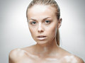 Portrait of beautiful young woman with drops of water around her face Royalty Free Stock Photos