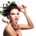 Portrait of beautiful young woman with flowers in hair. Royalty Free Stock Images