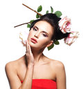 Portrait of beautiful young woman with flowers in hair. Stock Images
