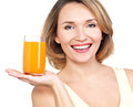 Portrait of a beautiful young woman with a glass of juice isolated on white Stock Image