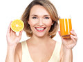 Portrait of a beautiful young woman with a glass of juice and orange isolated on white Royalty Free Stock Photos