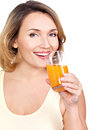 Portrait of a beautiful young woman with a glass of orange juice isolated on white Stock Photography