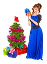 Portrait of a beautiful young woman holding a present near the C Royalty Free Stock Photo