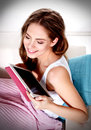 Portrait of a beautiful young woman holding a tablet white Stock Image