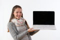 portrait of a beautiful young woman holding up a laptop and smiling against a white background Royalty Free Stock Photo