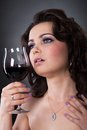 Portrait of beautiful young woman holding wine glass Stock Photo