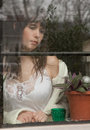 Portrait beautiful young woman looking out window Stock Photography