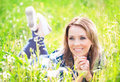 Portrait of a beautiful young woman lying in the grass Royalty Free Stock Photo