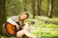 Portrait of a beautiful young woman playing guitar outdoors acoustic Stock Photos