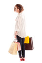 Portrait of a beautiful young woman posing with shopping bags different Stock Photography