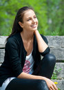 Portrait of beautiful young woman sitting outdoors Royalty Free Stock Photo