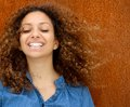 Portrait of a beautiful young woman smiling with curly hair close up Stock Photography