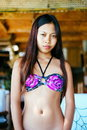 Portrait of beautiful young woman in swimsuit standing at the bar during summer on the beach Royalty Free Stock Photo