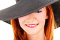Portrait of beautiful young woman wearing black hat Stock Photo