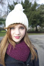 Portrait of beautiful young woman wearing scarf and knit cap Royalty Free Stock Photography